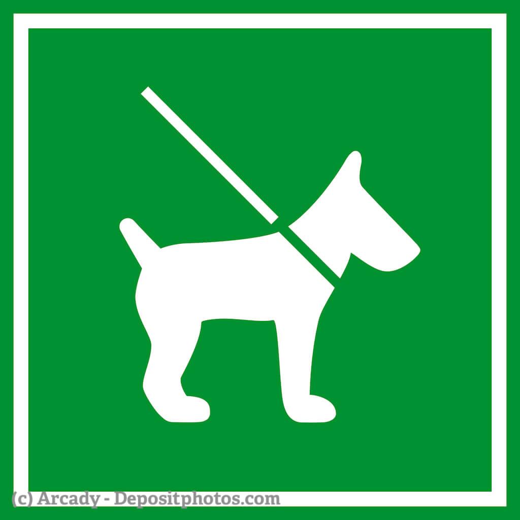 Ein grünes Schild mit einem stilisierten weißen Hund an einer weißen Leine
